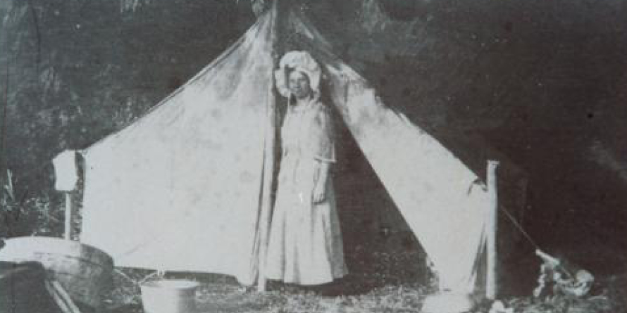 Photo of woman next to tent, 1909, Historic Blog