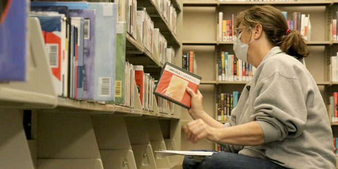 Customer browses Sultan Library shelf