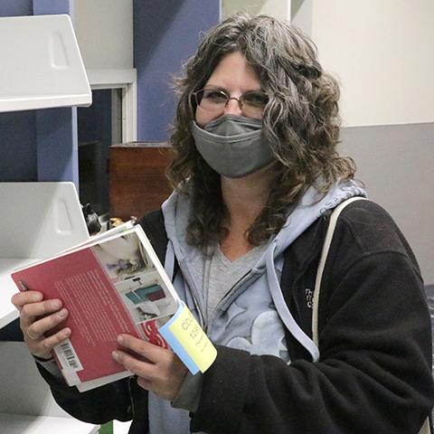 Customer Pam Cole inside Marysville Library